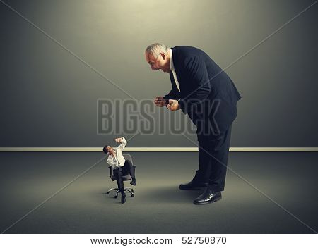 big boss screaming at small frightened businessman poster