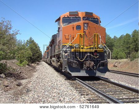 Freight train coming up a mountain pass