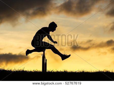 silhouette of hurdling