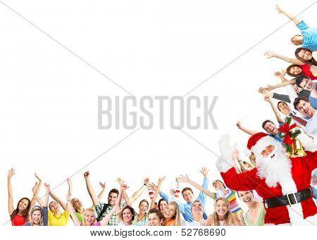 Happy people group and Santa dancing at christmas party