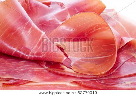 closeup of some slices of spanish serrano ham