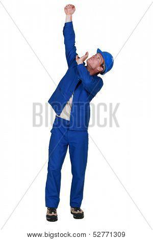 Manual worker lifting something