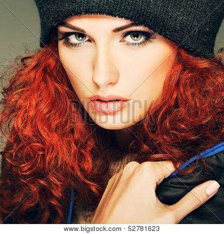 Portrait of sexual beautiful redheaded girl in a sportwear, is in fashion style