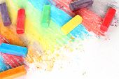 Color pieces of chalk on white background poster