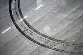 Abstract road background with crossing of road marking and tires track poster