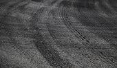Dangerous turn. Abstract road background with tires tracks on asphalt poster