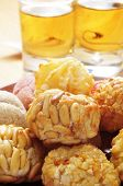 some panellets and some glasses with sweet wine, typical snack in All Saints Day in Catalonia, Spain poster