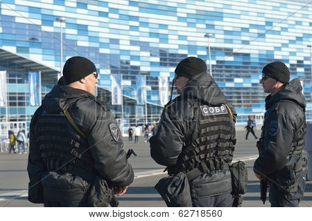 SOCHI, RUSSIA - FEBRUARY 12, 2014: Soldiers of SOBR protect a law and order in the park during Winter Olympics. SOBR is the special group of fast reaction used in antiterroristic operations
