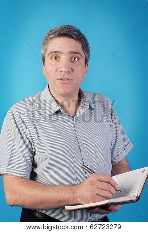 Businessman With Notebook And Pen