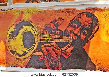 Painting of a black man playing tube