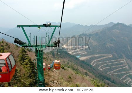 Cable Car Mast Standing In The Middle Of Mountain Forest.