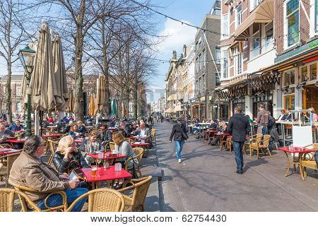 People Take A Drink At The Terraces of The Hague