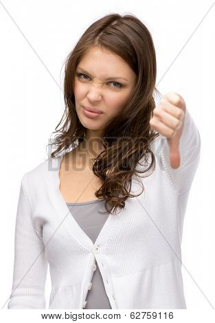 Half-length portrait of woman thumbing down, isolated on white