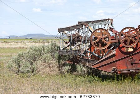 old abandoned grain combine in the Fort Rock area of Oregon's central high desert poster