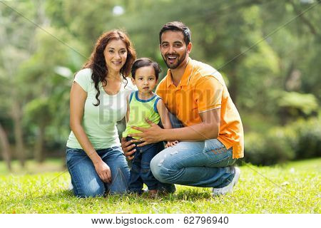 portrait of happy indian family outdoors