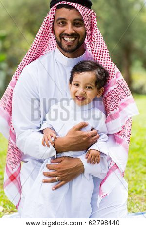 happy arabian father and son outdoors