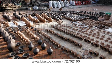 Newly made pottery drying in the sun at the Pottery Square of one of Nepals five king cities: Bhaktapur. poster