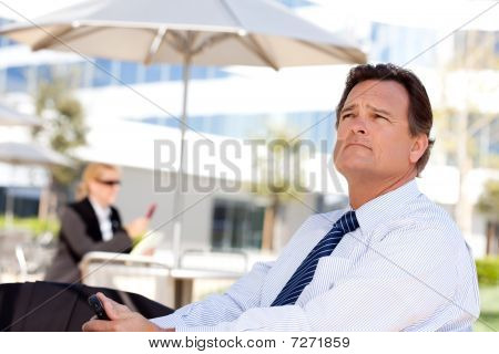 Handsome Businessman Looks Off Into The Distance