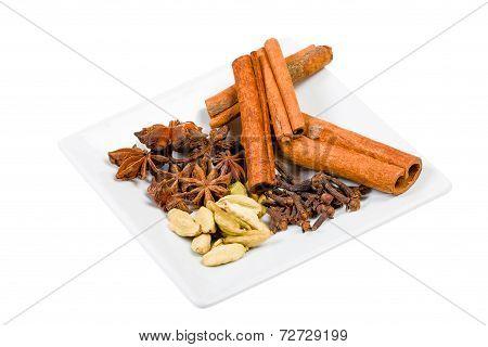 Cinnamon, Cloves, Cardamom, Anise