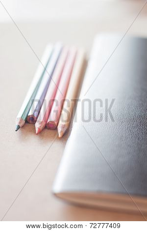Color Pencils With Black Notebook