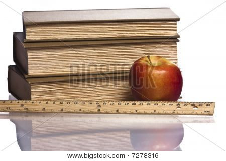 red apple books ruler reflection