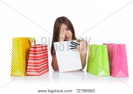 Beautiful Asian Woman Headache With A Credit Card Statement And Shopping Bags