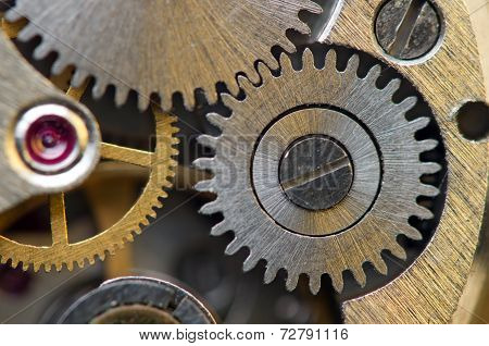 Metallic Background With Metal Cogwheels A Clockwork. Macro