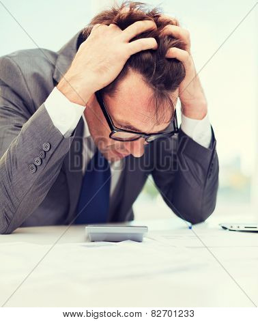 tax, business and stress concept - stressed businessman with papres, laptop and calculator poster