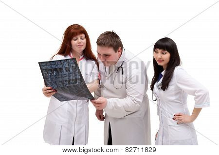 Image of curious interns looking at x-ray