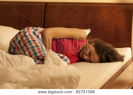 Woman suffering from depression sleeping in bed poster