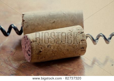 Two Corkscrew With Wine Corks. Macro View. Closeup. Soft Focus. Retro Style. Paper Texture Backgroun