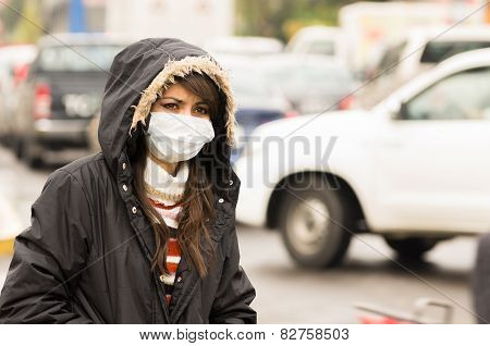 portrait of young girl walking wearing jacket and a mask in the city street concept of  pollution poster
