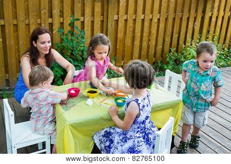 Children Outside Dyeing Easter Eggs