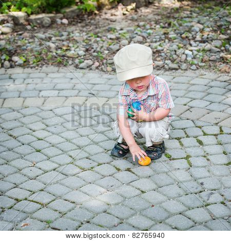 Little Boy Collecting Colorful Easter Eggs