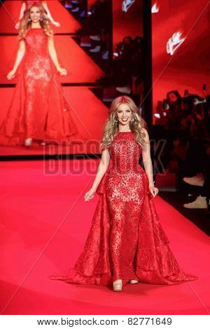 NEW YORK-FEB 12: Singer Thalia wears Shady Zein Eldein Go Red for Women - The Heart Truth Red Dress Collection at Mercedes-Benz Fashion Week at Lincoln Center on February 12, 2014 in New York City.