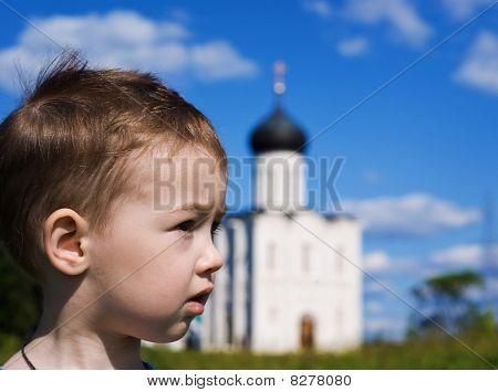 Little Boy On A  Orthodox Church Background