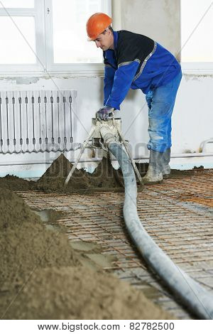 Plasterer at indoor floor concrete cement covering