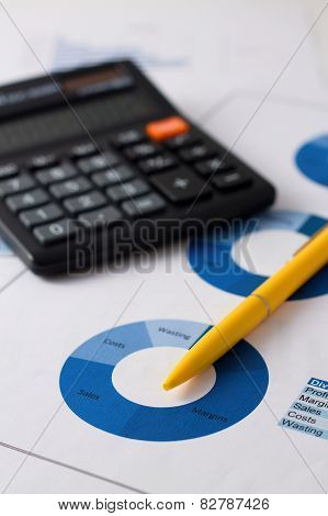 Yellow Pencil Placed On Blue Pie Chart