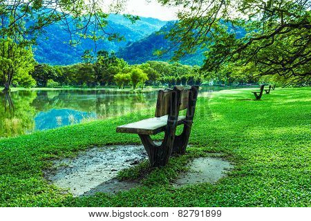Wooden Chair At Lake Garden