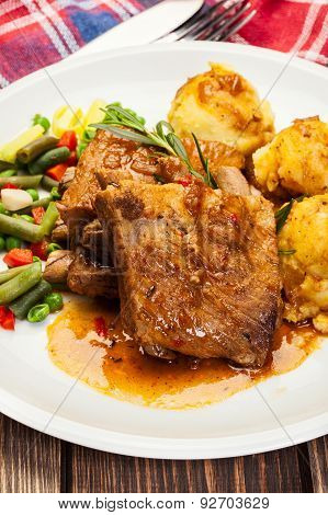 Pork Spareribs Served With Mashed Potatoes