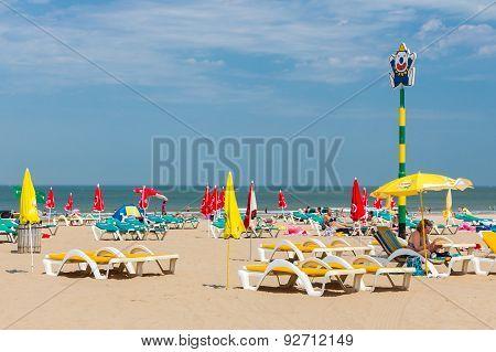 Seaside Visitors Relaxing In Beach Chairs At Dutch Beach Of Scheveningen