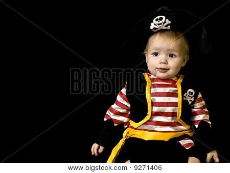 Adorable baby in a pirate costume