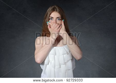 Secrecy, Reluctance, Talkativeness Concept. Woman Closed Her Mouth With Her Hands
