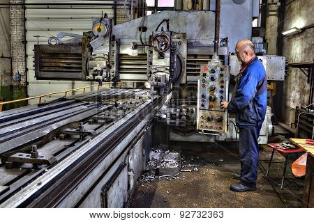 Machine Tool Operator Planing And Milling Double Column.