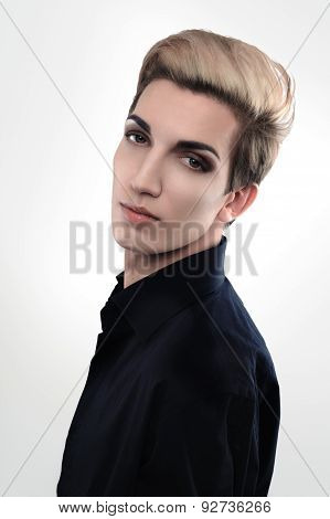 Handsome Androgynous Male Model Looks Over His Shoulder