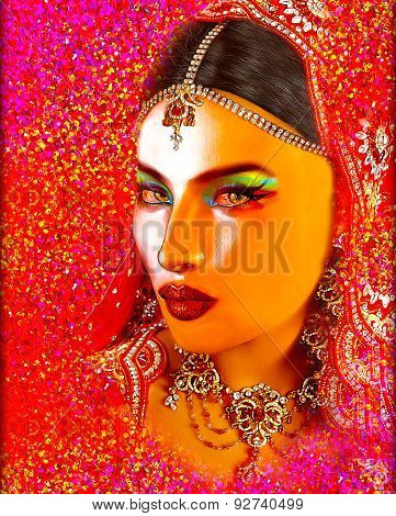 Abstract digital art of Indian or Asian woman's face, close up with colorful veil. An oil paint effe