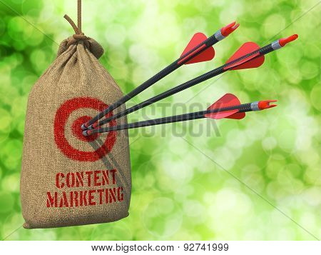 Content Marketing - Arrows Hit in Red Target.