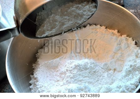 Measuring And Pouring Confectioner's Sugar