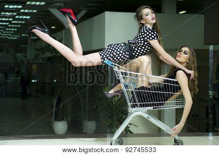 Two Winning Girls In Shopping Trolley