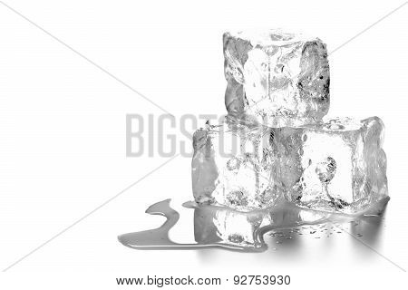 Heap of three ice cubes melting with water over white background poster
